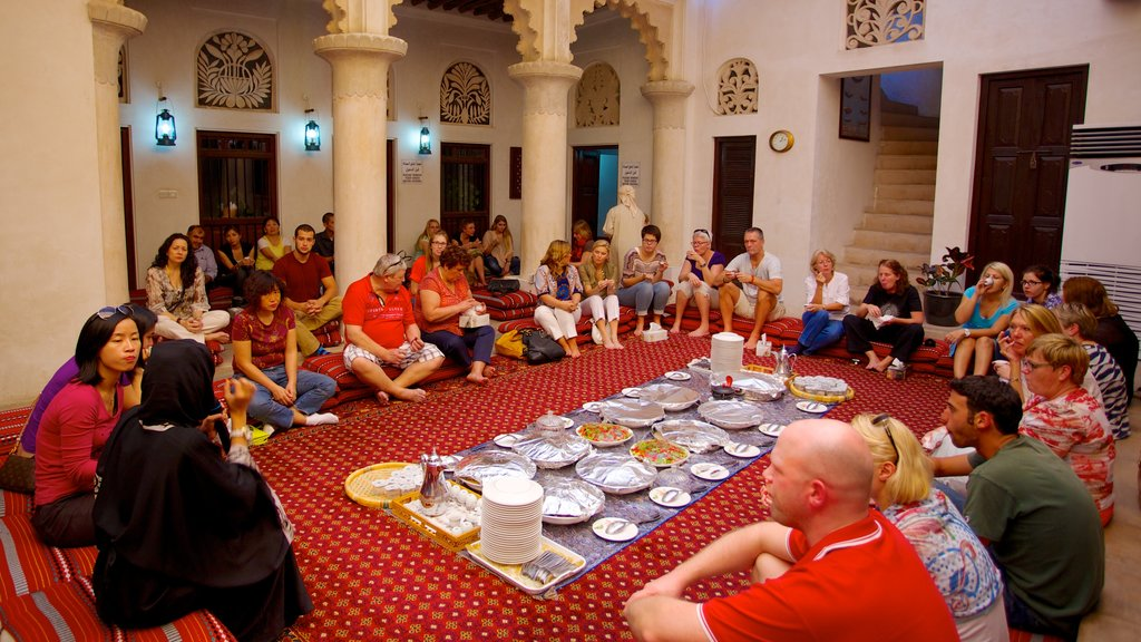 Dubai Emirate which includes food and interior views as well as a large group of people
