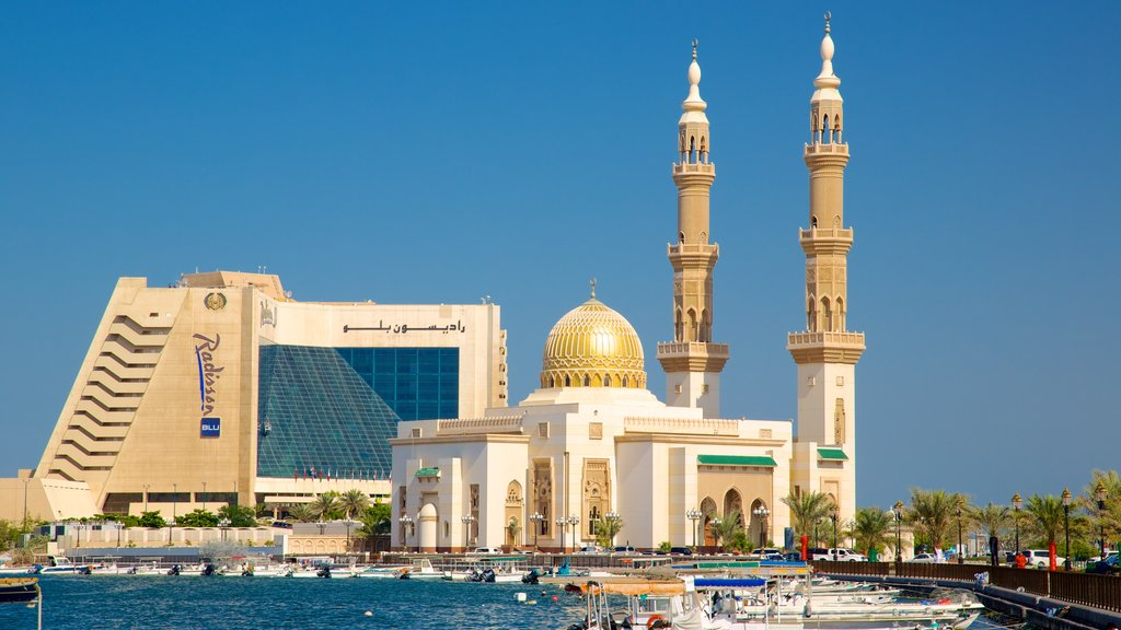 Sharjah showing religious elements, a mosque and modern architecture