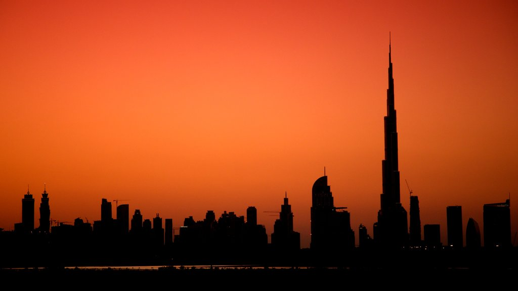 Dubai Emirate featuring modern architecture, a sunset and skyline