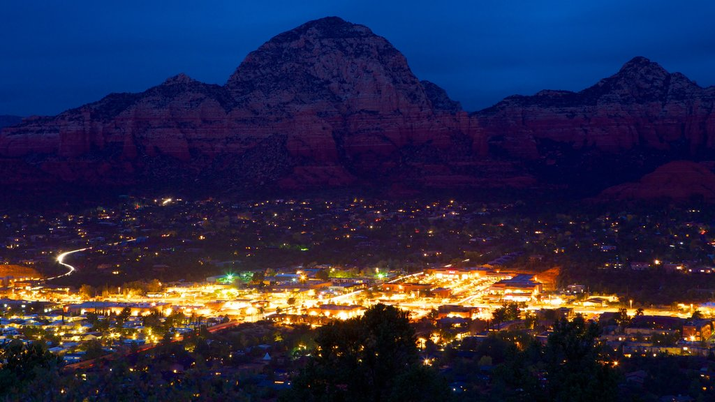 Sedona showing mountains, a gorge or canyon and a city