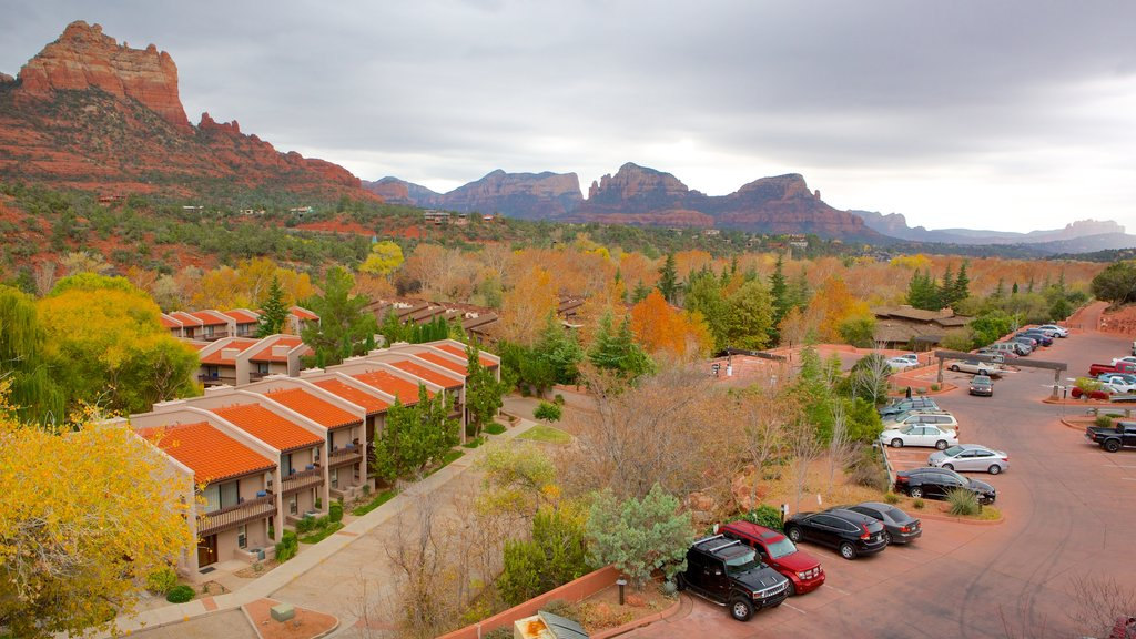 Sedona showing a small town or village, a gorge or canyon and fall colors