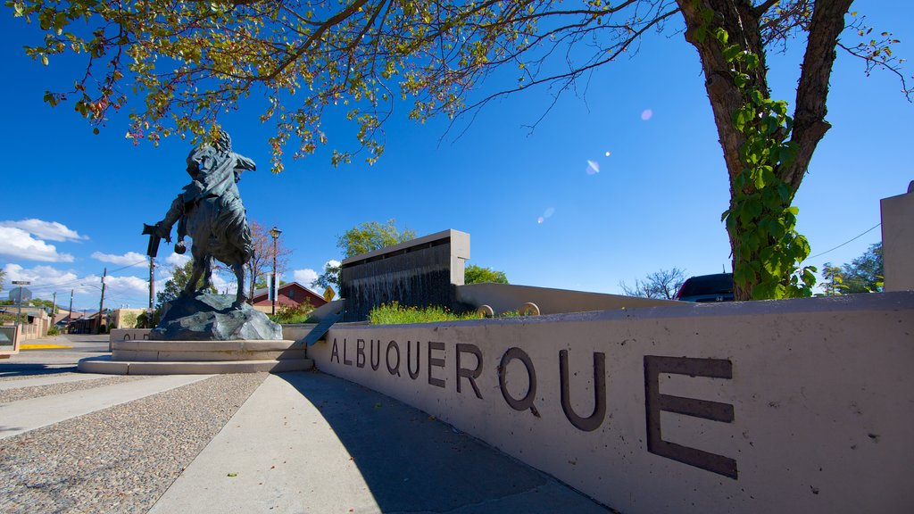 Albuquerque showing signage and a statue or sculpture
