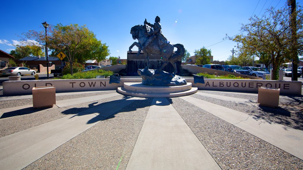 Albuquerque featuring signage, a statue or sculpture and a square or plaza