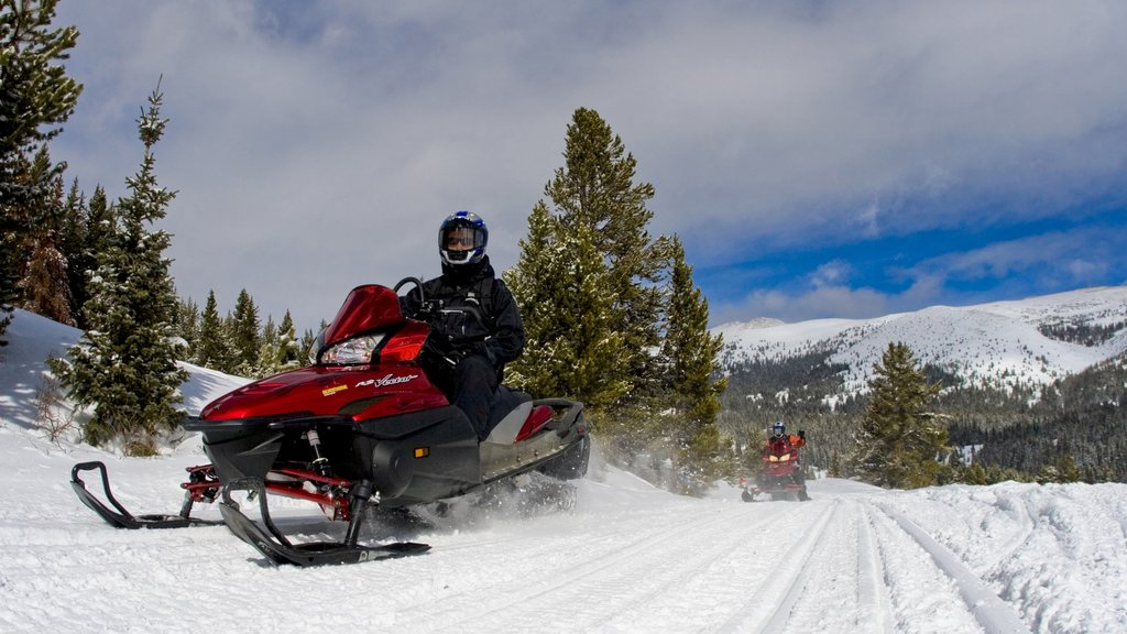 Vail Ski Resort showing snow and snowmobiling as well as an individual male