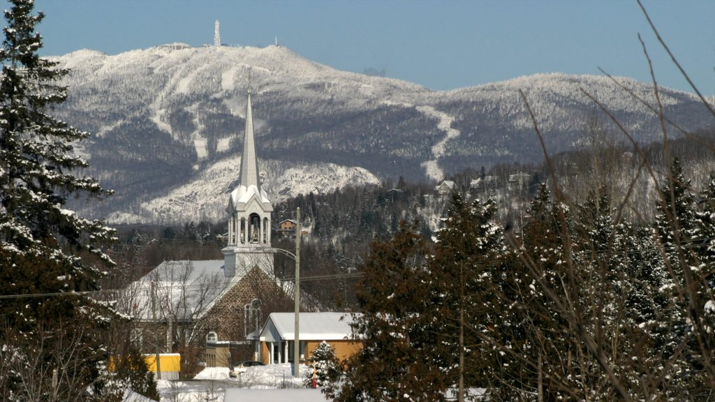 Mont-Tremblant which includes mountains, snow and a church or cathedral