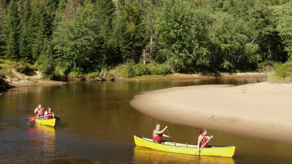 Mont-Tremblant featuring kayaking or canoeing and a river or creek as well as a small group of people