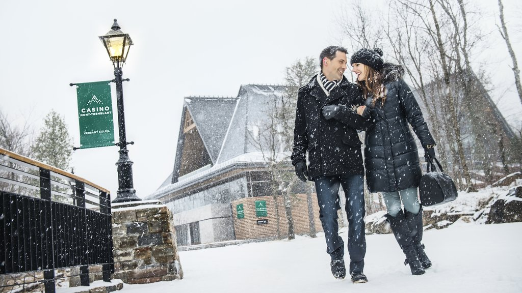 Mont-Tremblant which includes a small town or village and snow as well as a couple