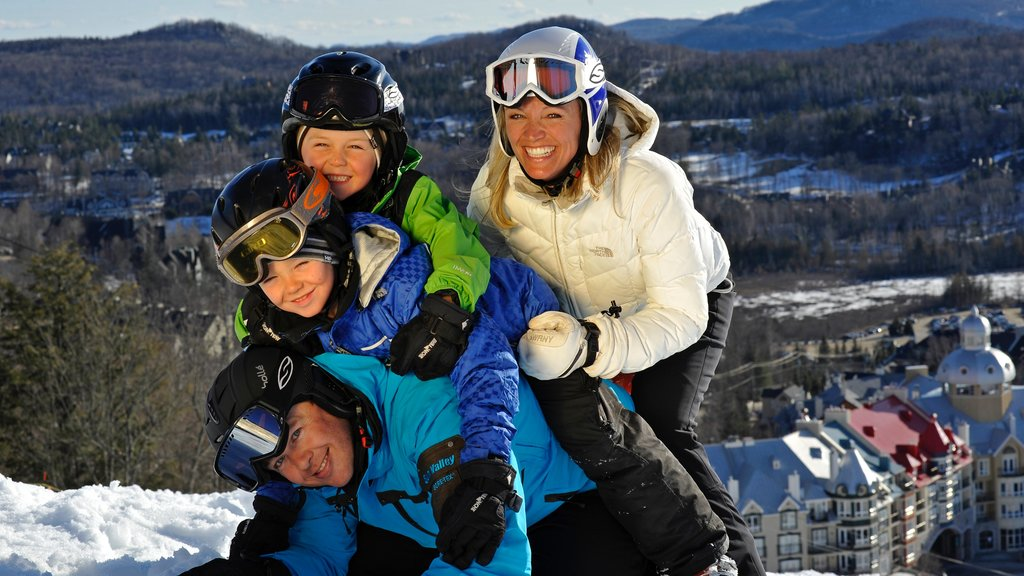 Mont-Tremblant showing snow as well as a family