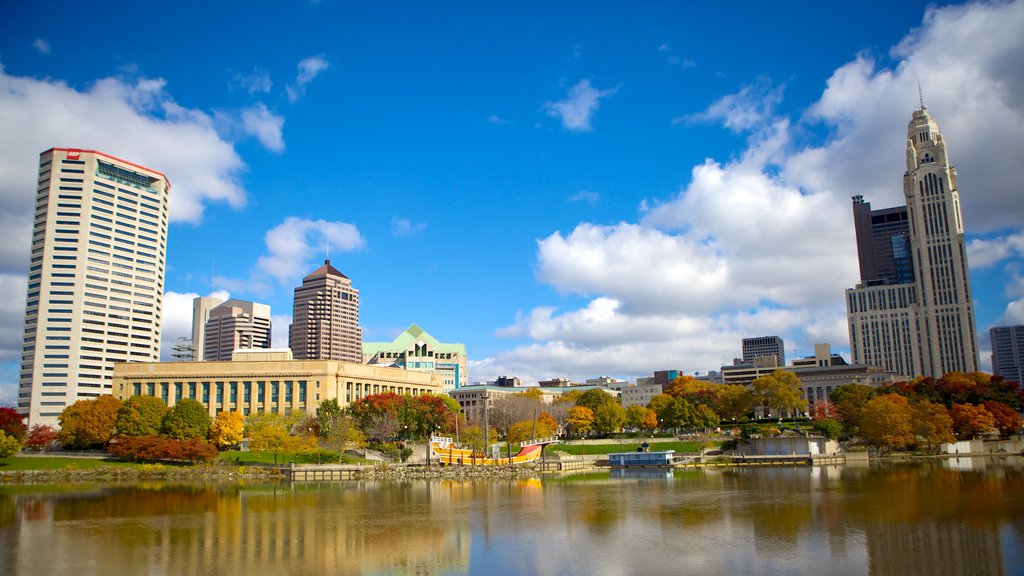 Columbus featuring a garden, skyline and a pond