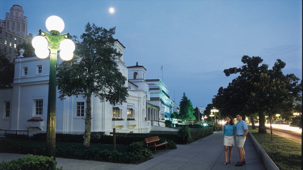 Lava Hot Springs featuring night scenes and heritage architecture as well as a couple