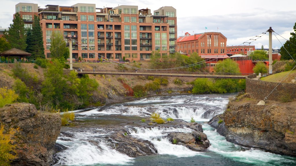 Spokane showing a city, a suspension bridge or treetop walkway and rapids
