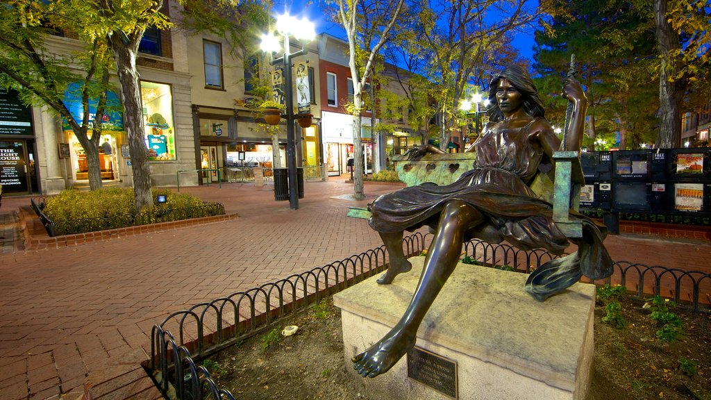 Boulder featuring night scenes, a statue or sculpture and a small town or village
