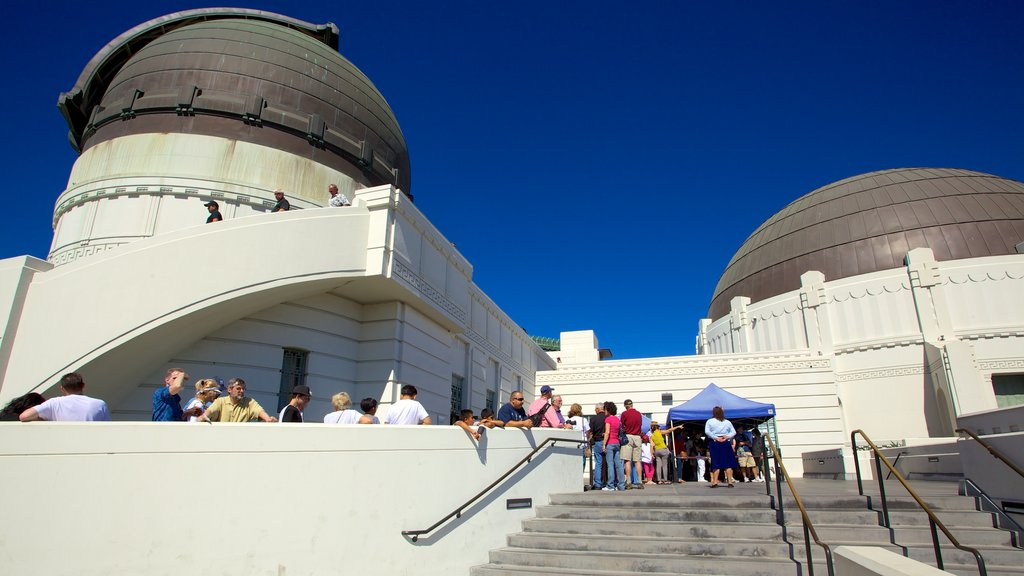Griffith Observatory showing an observatory as well as a large group of people