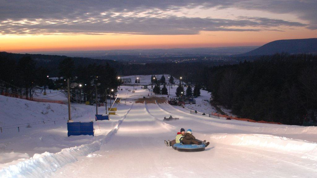 State College showing snow, snow tubing and a sunset