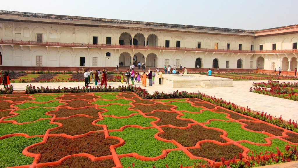 Agra Fort featuring a garden, a square or plaza and heritage architecture