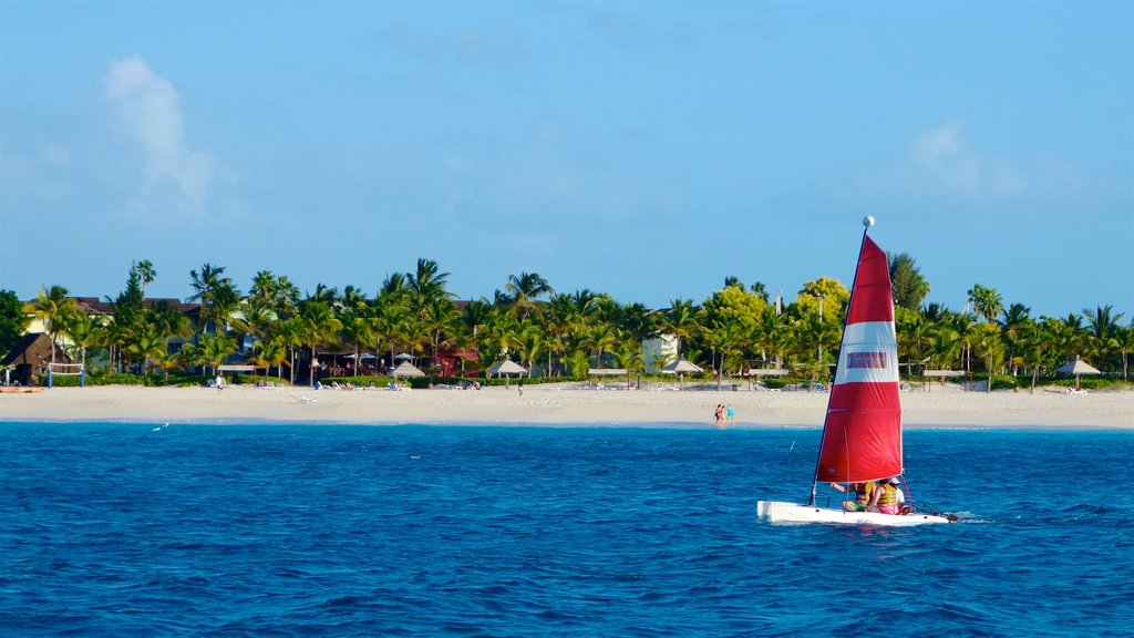 Turks and Caicos which includes a coastal town, tropical scenes and a sandy beach