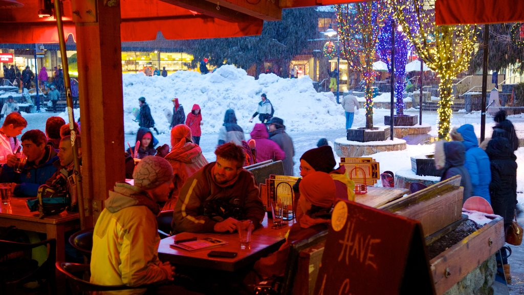 Whistler featuring outdoor eating and snow as well as a small group of people