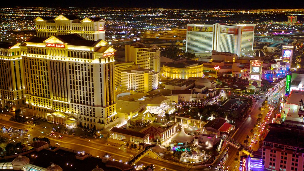 The Strip showing a casino, night scenes and a city