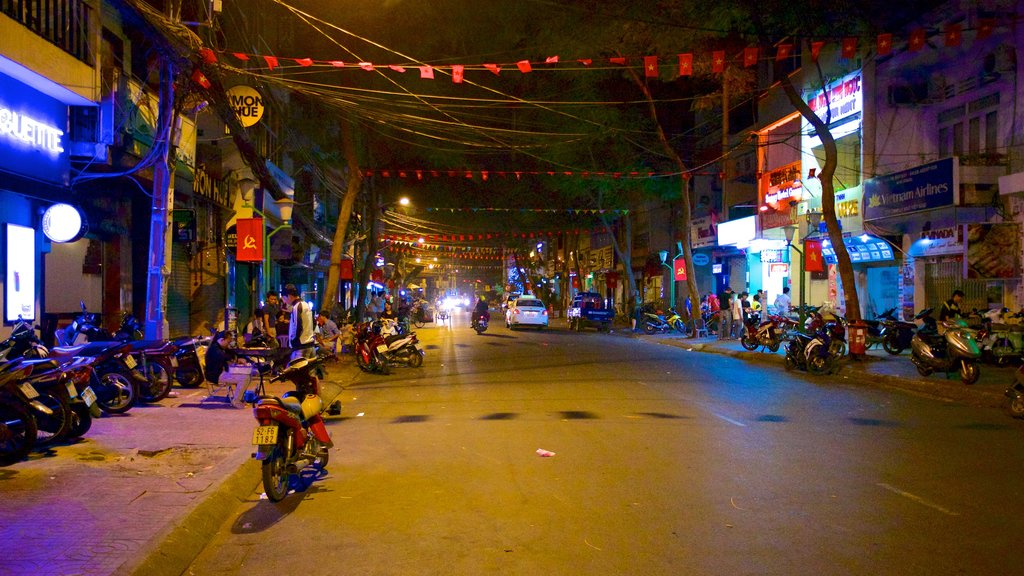 Southern Vietnam featuring motorbike riding, nightlife and night scenes