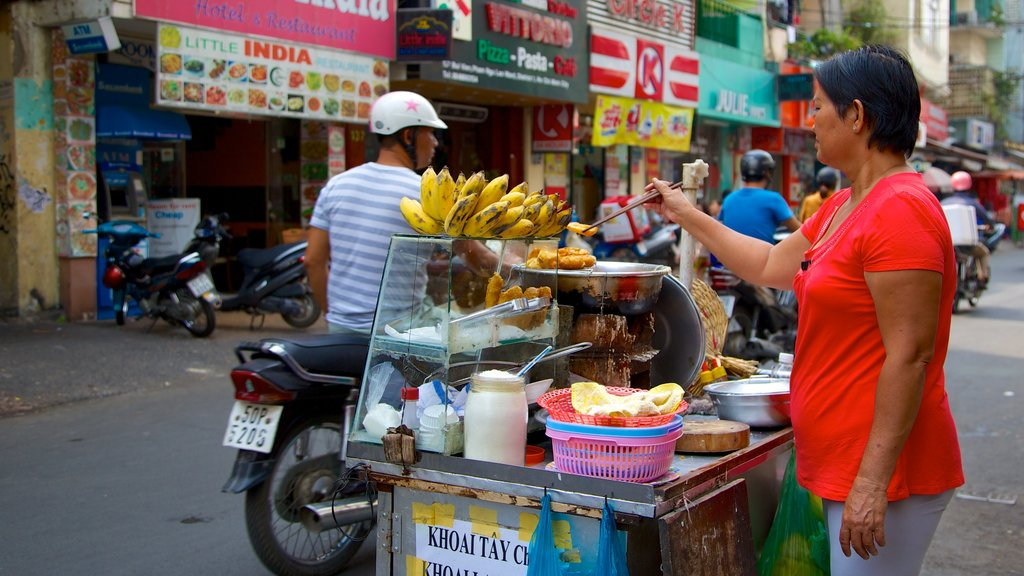 Pham Ngu Lao Street which includes street scenes, motorcycle riding and a city