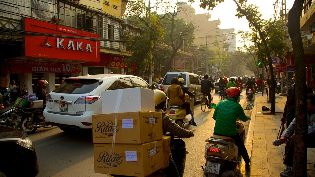 Hanoi which includes a city, motorbike riding and signage