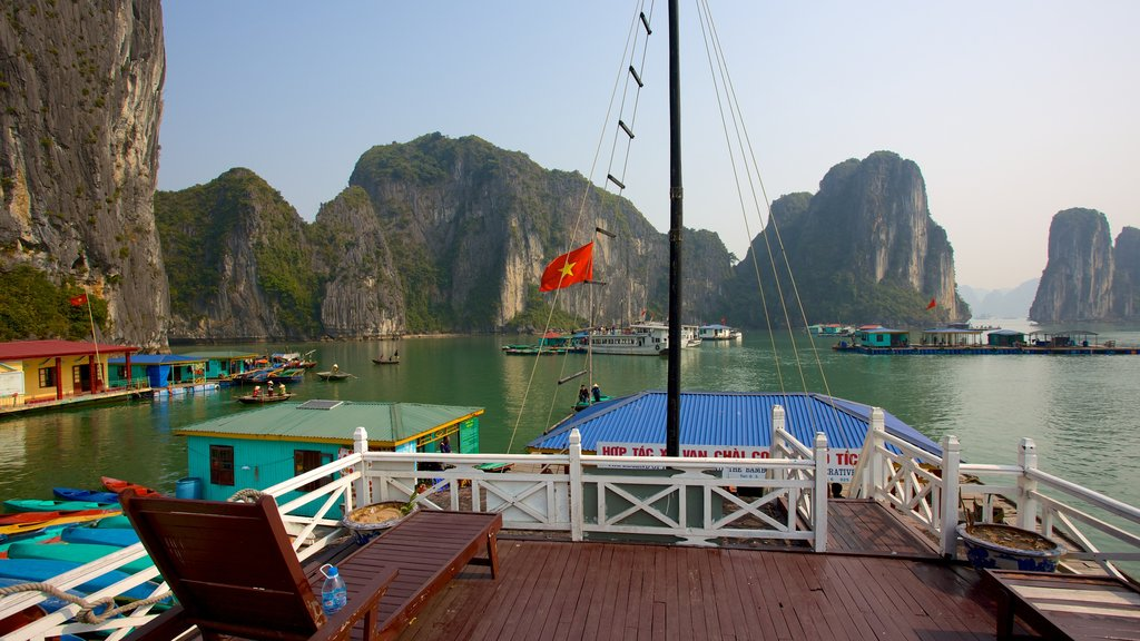 Halong Bay featuring a bay or harbor, rugged coastline and boating