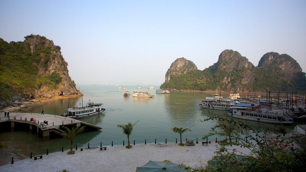 Halong Bay showing a coastal town, a ferry and landscape views