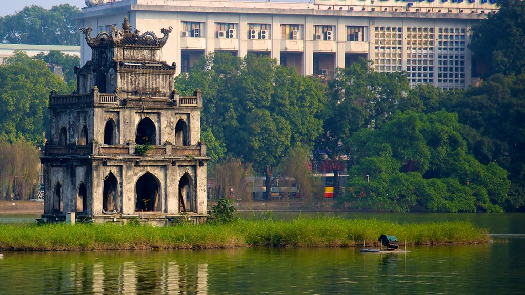Hoan Kiem Lake showing a monument, heritage architecture and a lake or waterhole