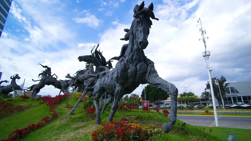 Guadalajara featuring a statue or sculpture, a park and outdoor art