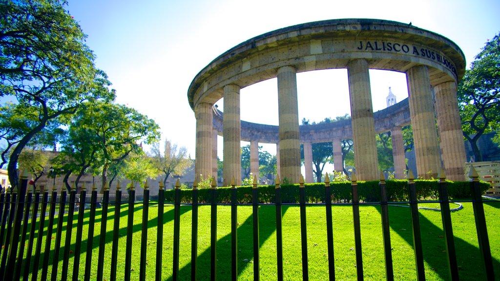 Rotonda de los Hombres Ilustres featuring a garden, a memorial and heritage architecture