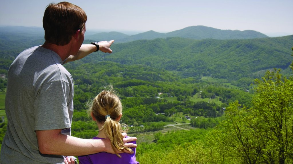 Roanoke featuring mountains and tranquil scenes as well as a family