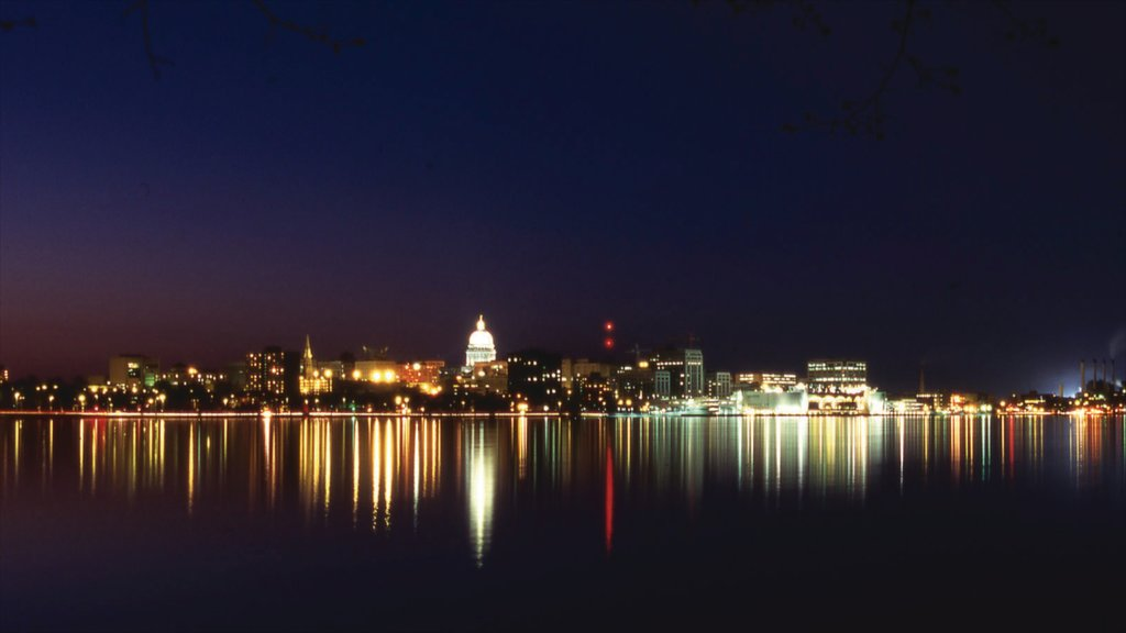 Madison which includes night scenes, skyline and a lake or waterhole