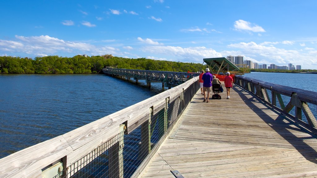 John D. MacArthur Beach State Park which includes general coastal views and a bridge as well as a family