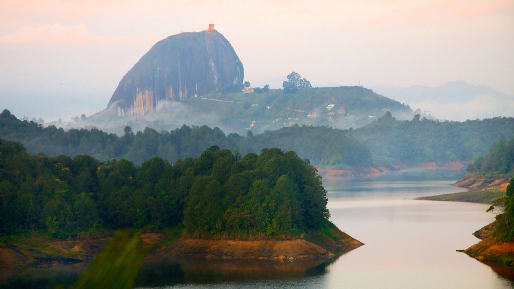 Rock of Guatape featuring landscape views, mist or fog and a river or creek