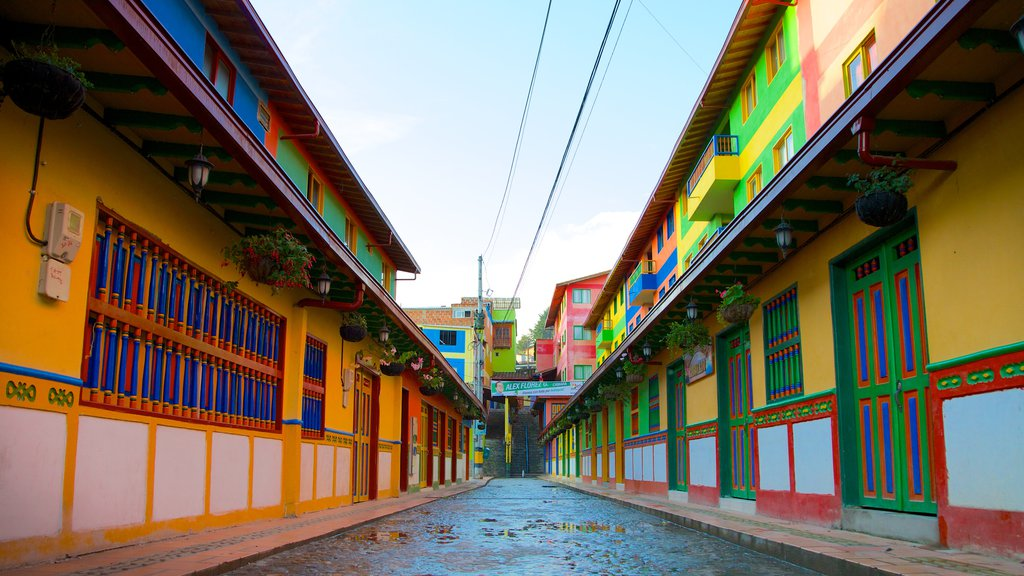 Rock of Guatape featuring heritage elements and street scenes