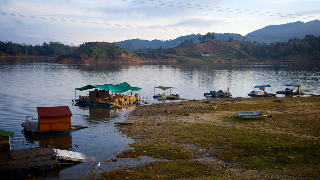 Rock of Guatape featuring a bay or harbor, wetlands and tranquil scenes