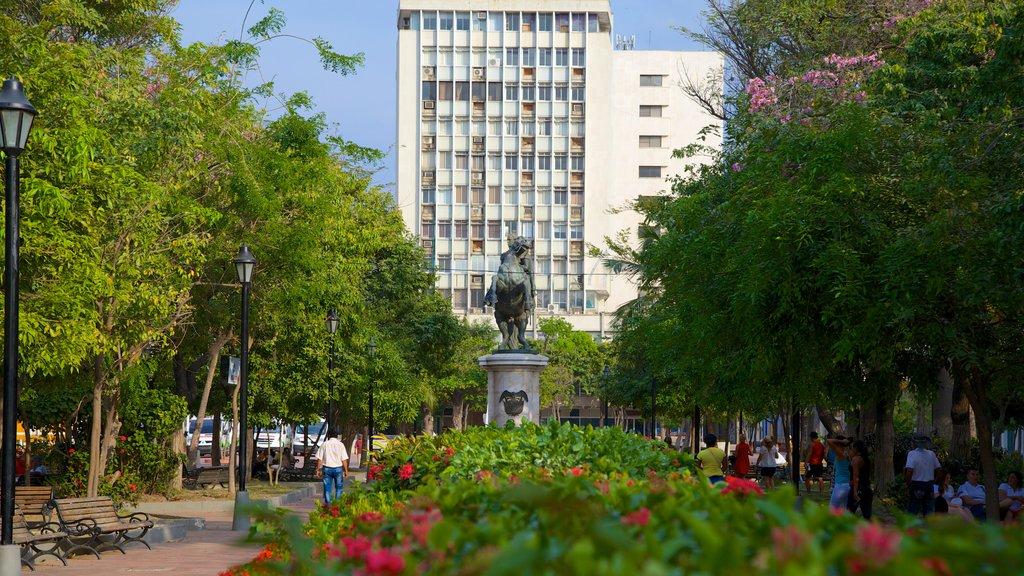 Plaza de Bolivar which includes a park and a statue or sculpture