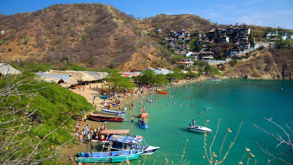 Taganga Beach showing a bay or harbor, a coastal town and a sandy beach