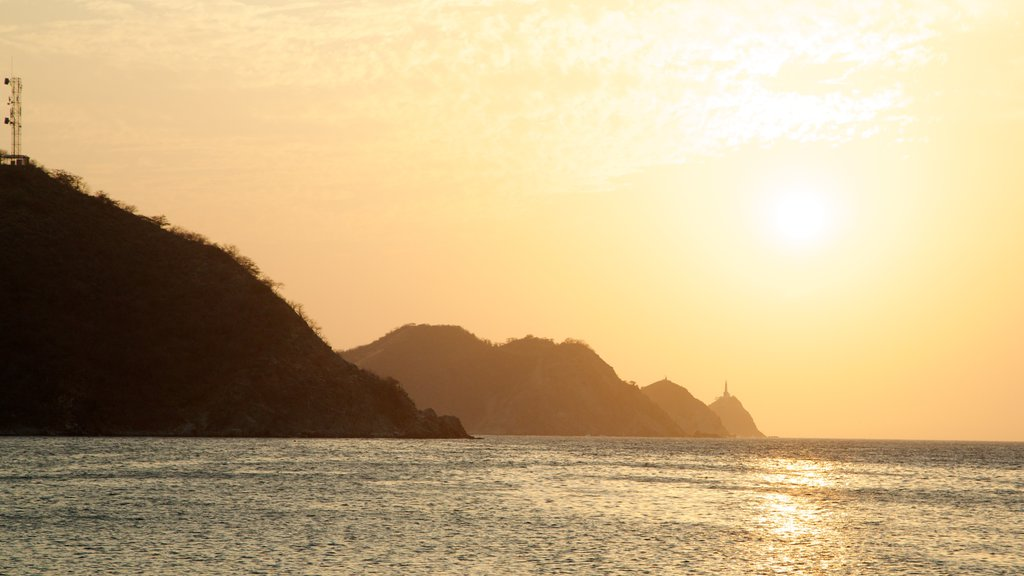 Taganga Beach showing landscape views, general coastal views and a sunset