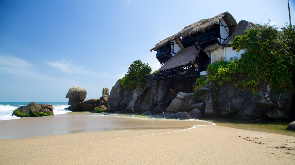 Santa Marta featuring rocky coastline, a house and a sandy beach