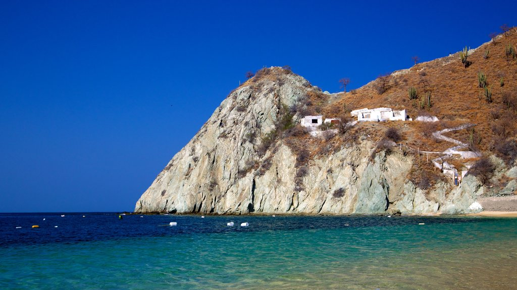 Blanca Beach featuring general coastal views, rocky coastline and mountains