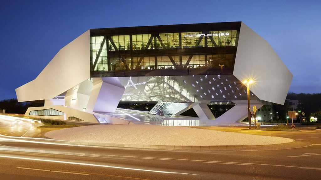 Porsche Museum showing night scenes and modern architecture