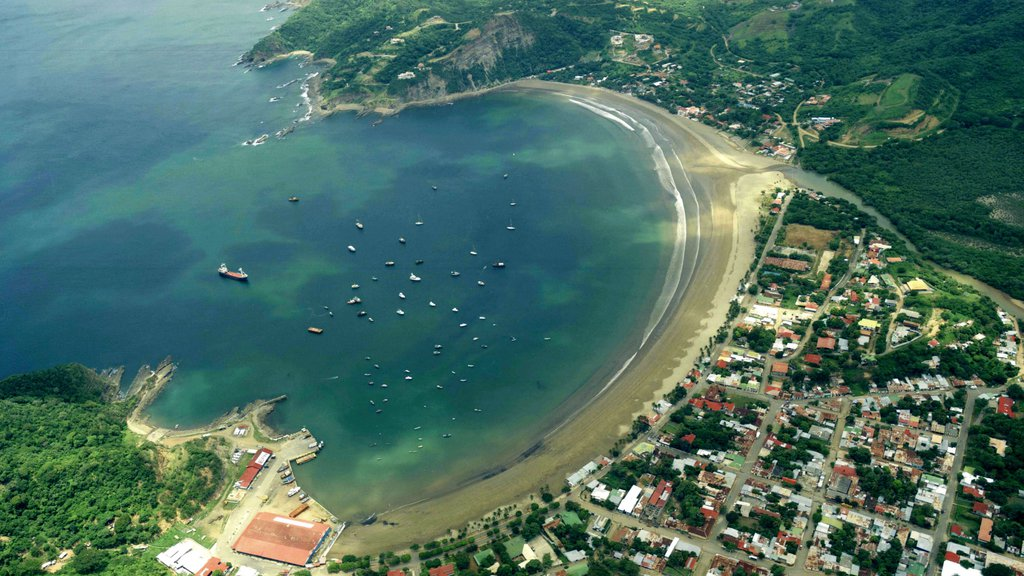 San Juan del Sur showing a sandy beach, a bay or harbor and a coastal town