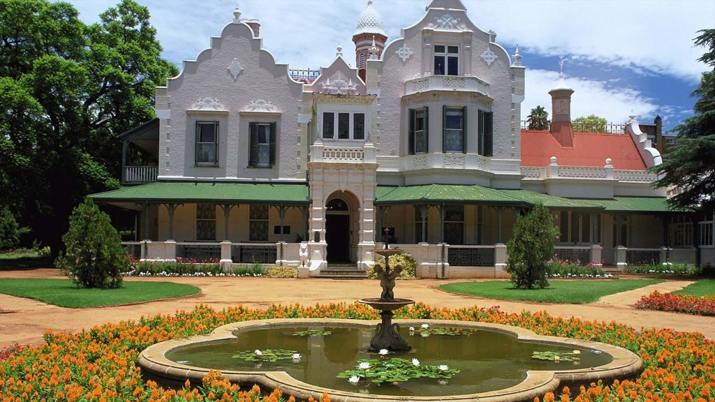 Pretoria featuring flowers, heritage architecture and a fountain
