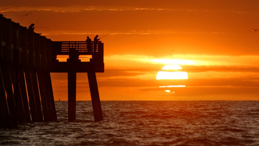 Jacksonville Beach Pier featuring general coastal views, fishing and a sunset