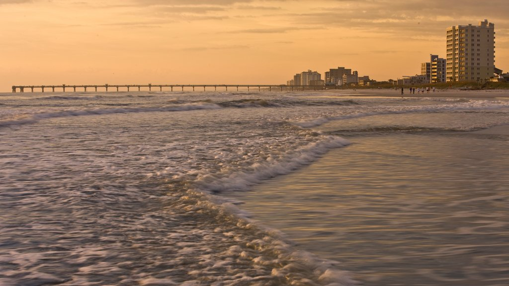 Jacksonville Beach featuring a sunset, general coastal views and surf
