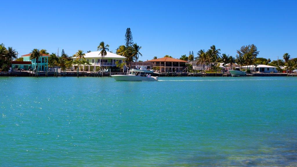 Marathon showing boating, a house and general coastal views