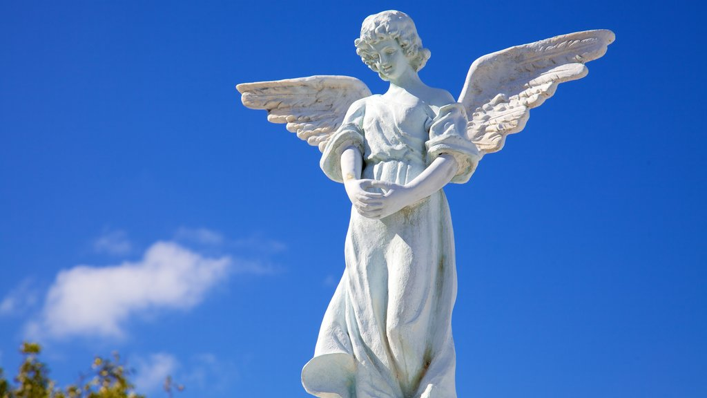 Key West Cemetery showing a statue or sculpture and a cemetery