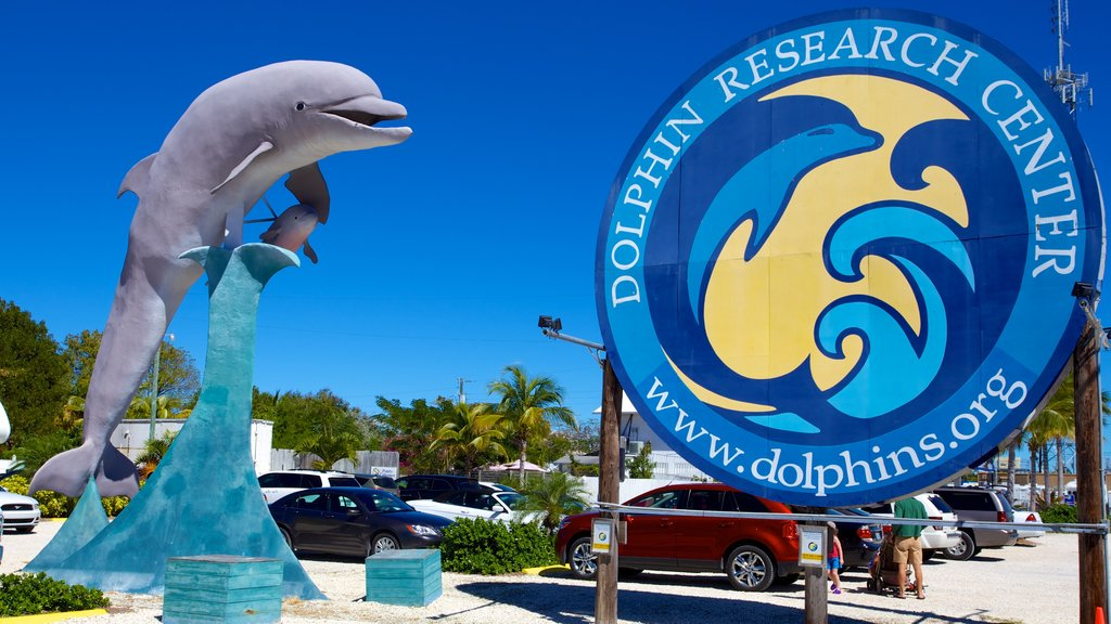 Dolphin Research Center showing a statue or sculpture and signage