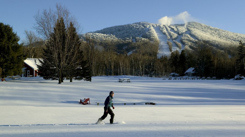 Vermont featuring snow shoeing and snow as well as an individual male